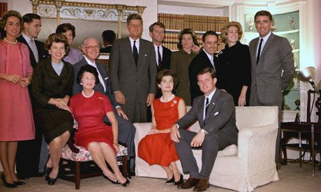 Following John F Kennedy's election as President, the family gathered for a photo on November 9, 1960.  Shown standing, left to right are:  Mrs Robert F Kennedy; Steve Smith and his wife, Jean Kennedy; John F Kennedy; Robert Kennedy; sister, Patricia Lawford; Sargent Shriver; brother Ted's wife, Joan; and British actor, Peter Lawford. In foreground:  Eunice Shriver, a sister; Joseph P Kennedy with wife seated in front; Jacqueline Kennedy, and Ted Kennedy.   Photograph: AP