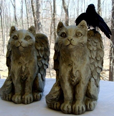 Pegapuss winged cat gargoyle statues.