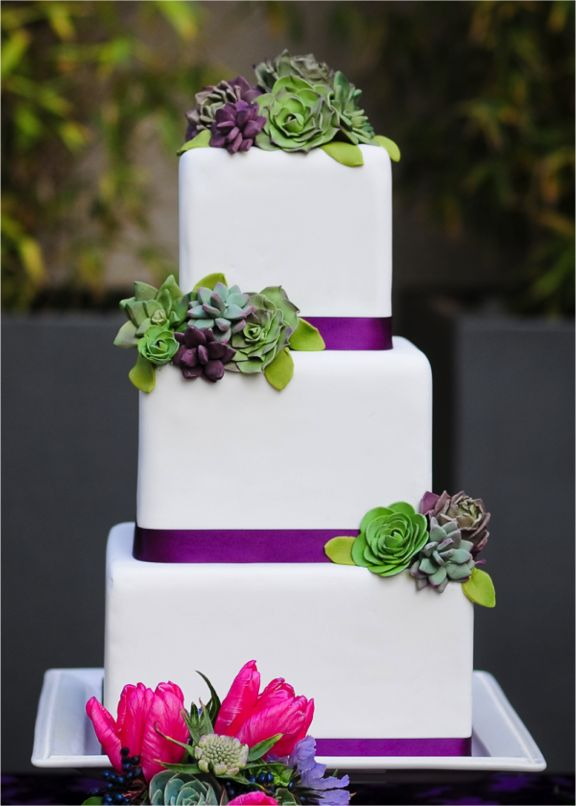 green and purple succulents on wedding cake
