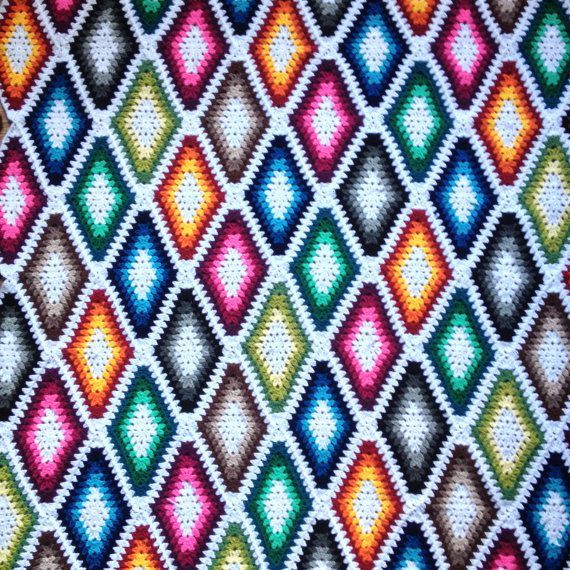 Make your own stylish blanket/throw!  Good old granny square with a new twist ;) Simple, yet effective!  Here is a pattern for you - pdf consists of 13 pages of written instructions (US crochet terms) and pictures explaining harder parts.  And if after reading and trying out you have any additional questions - contact me and I will try to answer you as soon as possible ;)  Also available on ravelry - http://www.ravelry.com/patterns/library/harlequin-longgrannydia...