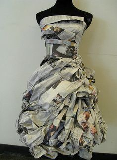 Newspaper Dress with lovely texture detail // fashion meets art. This dress is poportioned perfectly to the pont where it looks like something cute to wear out. I enjoy how the person only used news paper to make it look so form fitting. It looks elegant and worth money instead of just recyecled news paper.