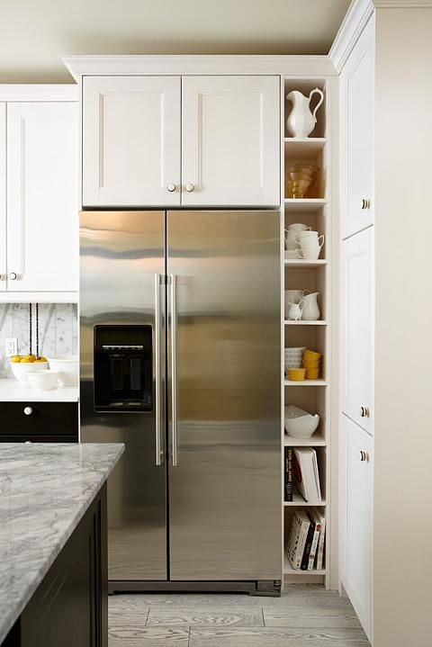 Kitchen with black base cabinets, white upper cabinets -- Sarah 101, Season 2: Dream Budget Kitchen -- design by Sarah Richardson -- photo by Stacey Brandford
