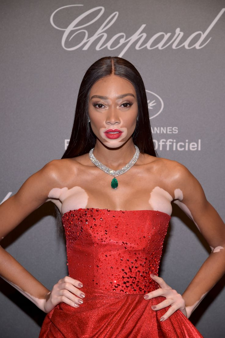 Canadian model Winnie Harlow wore a statement necklace from Chopard's Red Carpet collection, set with a glowing emerald and diamonds. With a strapless floor length voluminous red gown with beading. As seen at the Chopard Space Party. For glamour celebrity fashion Cannes Film Festival red carpet jewellery spotting travel here: http://www.thejewelleryeditor.com/jewellery/top-5/cannes-film-festival-red-carpet-jewellery-day-two/ #jewelry
