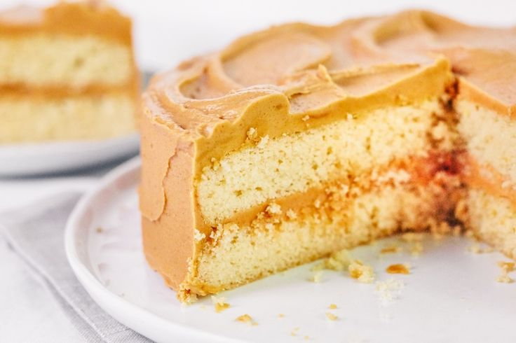The BEST ULTIMATE Caramel Cake Recipe. Easy enough to make from scratch in an afternoon, but impressive enough to knock the socks off your guests! Make this southern classic ASAP.