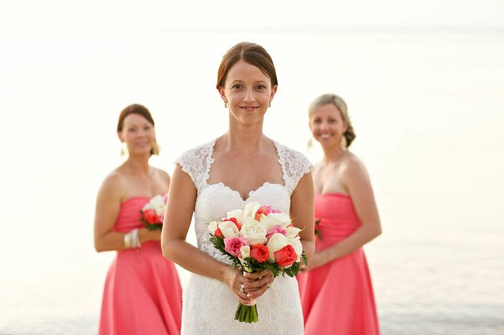 Compliment the dresses with the flowers rather than try to match them exactly - looks gorgeous and saves stress! Faraway Beach weddings Thailand
