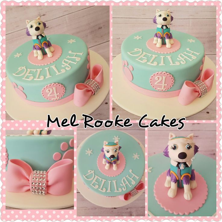 Pink and aqua paw patrol cake with Everest figurine, paw prints and bling bow