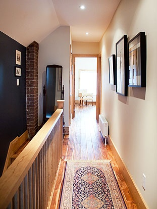 Brock Street Renovation -  The upstairs hall is personalized by the presence of the original brick chimney breast.