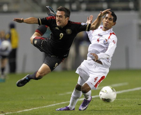 Mexico's Jeronimo Amione (9) is knocked into the air by Panama's Carlos Rodriguez (4) for a foul in the second half of their CONCACAF Olympic qualifying soccer match in Carson, California March 27, 2012.