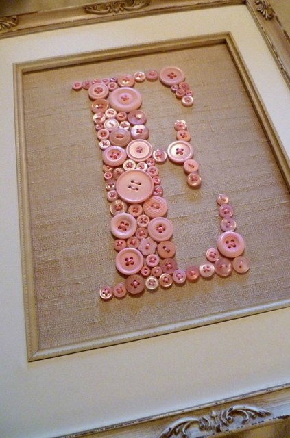 Monogram Button Art, I've done something similar but made it with buttons, and tons of tiny little children's trinkets, itty bitty toys, miniature hair accessories etc