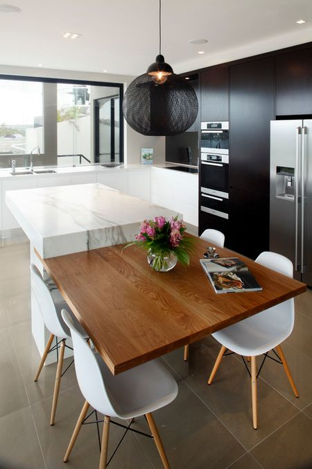 Matt black kitchen tower with white cabinetry and marble benchtops