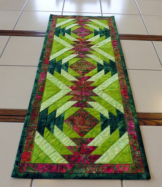 Lively Bright Red and Green Quilted Batik Table Runner https://www.etsy.com/listing/523265867/bright-red-and-green-quilted-batik-table?ref=shop_home_active_10