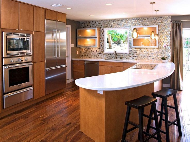 Central Austin Contemporary Kitchen with Slab Door and Curved Peninsula