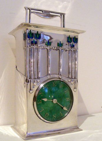 LIBERTY CLOCK       Arts and Crafts silver and enamel travel clock with original case.   Designed by Archibald Knox  Liberty & Co