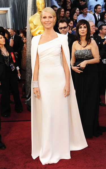 Academy Awards 2012: Gwyneth Paltrow looked simply chic and pristine with a dramatically white-capedTom Ford Couture gown. Not many could wear sleek white, but Gwyneth is stunningly regal.