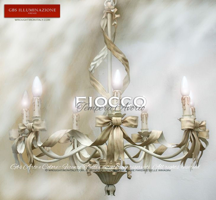 Bow Chandelier  Bow 7-light Chandelier in ivory white tempera, with ribbons and bows. Antique tempera finish.