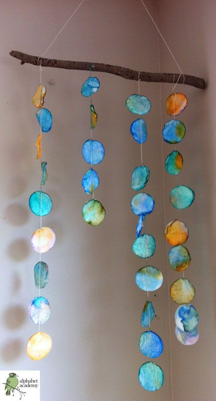 Such a beautiful mobile/wall hanging! Friends used pipettes to drip watercolors over cotton rounds. Those were then sewn onto string and suspended from a branch.