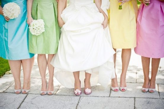 rainbow bridesmaids dresses http://burnettsboards.com/2012/11/rustic-rainbow-wedding/