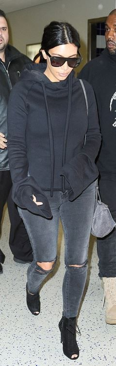 Kim Kardashian: Sunglasses – Saint Laurent  Purse – Givenchy  Shoes – Tom Ford  Jeans – J Brand  Sweatshirt – Vetements
