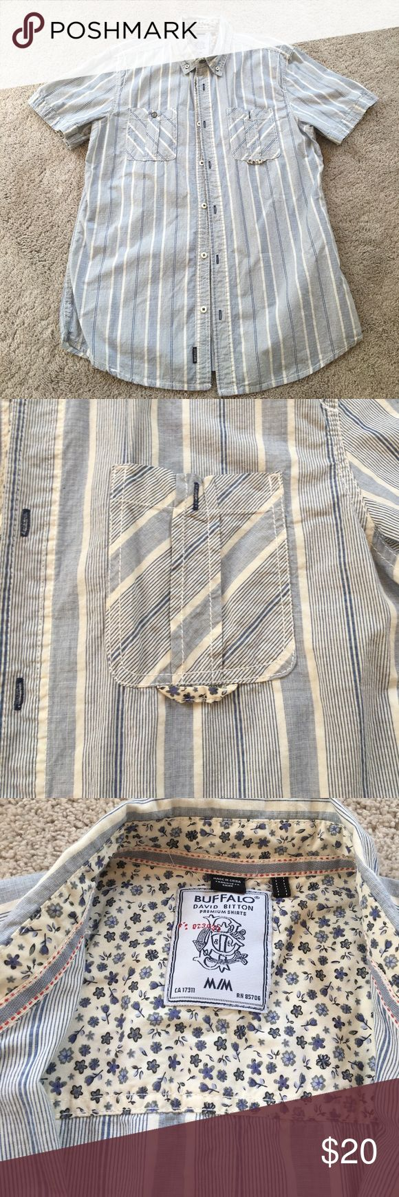 Buffalo David Bitton short sleeve shirt M Buffalo David Bitton short sleeve button up casual shirt Medium. Blue and white vertical striping with blue and white floral details. Worn a handful of times in excellent condition. Buffalo David Bitton Shirts Casual Button Down Shirts