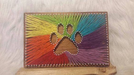 Hey, I found this really awesome Etsy listing at https://www.etsy.com/listing/221128434/rainbow-colored-paw-print-string-art