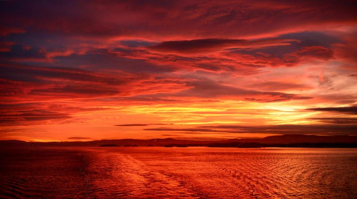 Sun's glare during the day is replaced by a lively red stage curtain in the evenings. The radiant heat has disappeared.   What is left is the cool afterglow. But the sun's heat and power is still visually detectable by the fiery red sky.