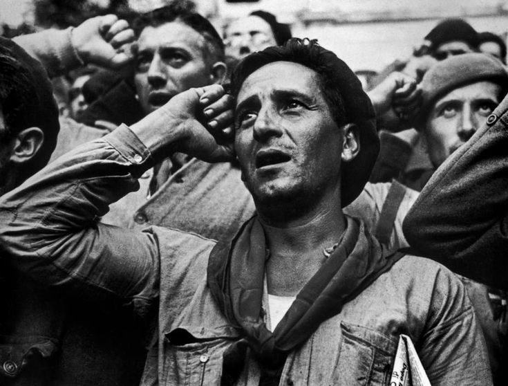 Robert Capa October 25th, 1938  Montblanch, near Barcelona Bidding farewell to the International Brigades, which were dismissed by the Republican government, as a consequence of Stalin's friendship with Germany.