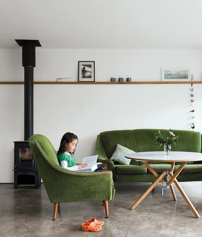 A late-1950s set of sofa and chairs inherited from Gaffney's granny warm up the living room, as do the stove from Charnwood and the coffee table the couple bought from Habitat for their first flat.  Photo by Ben Anders.
