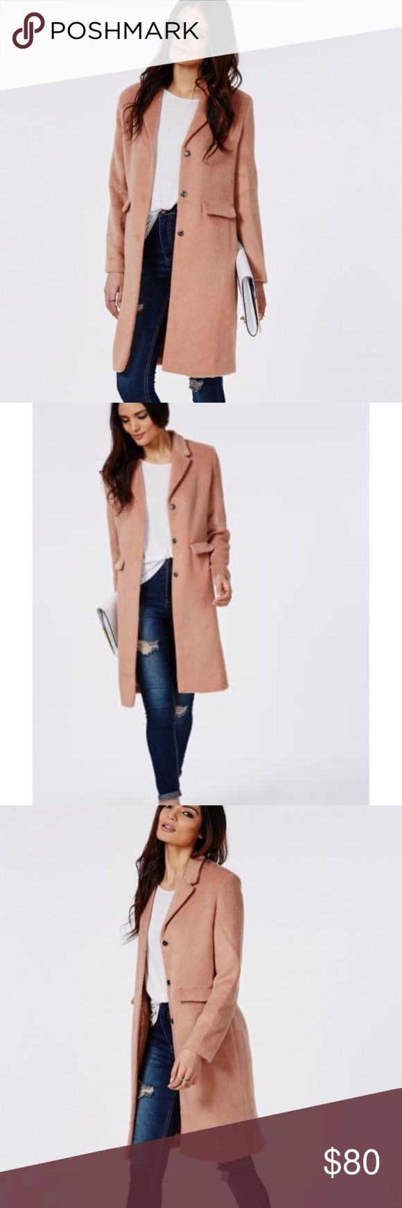 """Missguided Hether Tailored Boyfriend Coat Worn twice. Tailored, chic and in the coolest colour of the season, our blush three quarter length coat is an investment to make. With a jacket collar and two pockets, the detail gives a masculine edge to the feminine soft touch fabric creating the perfect balance of trends. Wear yours with neutral tones of cream, grey, black or navy for catwalk-worthy style. Fully lined Approx length 96cm/38"""" (based on a UK size 8 sample) 100% Polyester Missguided…"""