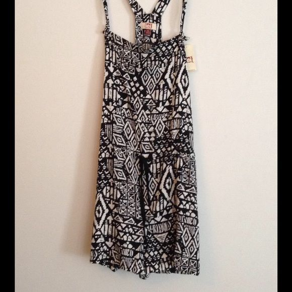 Print Romper Cute and comfy romper. 100% rayon. Shoulder Straps can be adjusted to your liking. Can be worn on top of a T shirt, tank top,strapless bra or bathing suit. L.e.i. Other