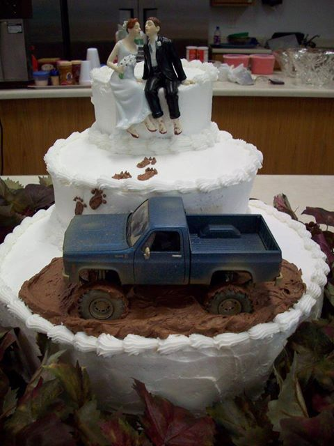 """Mud truck wedding cake - complete with our Whimsical Sitting Bride and Groom Cake Topper! Love the little """"muddy"""" footprints that lead up to them!"""