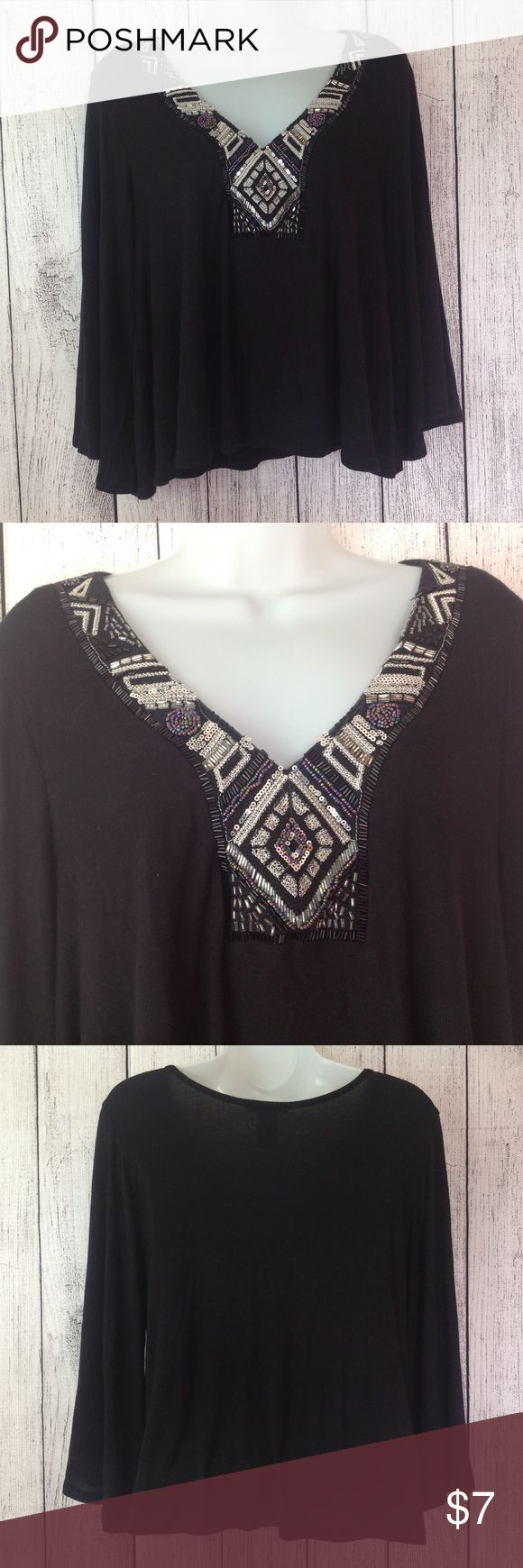 """Black Beaded Embellished Boho style Blouse Maker: Charlotte Russe ♥ Material: 95% Rayon - 5% Spandex ♥ Color: Black ♥ Measured Size: Pit to pit- 21"""" Pit to cuff- 12"""" Shoulder to waist- 19"""" ♥ Tag Size:  Large ♥ Actual Size: Large PLEASE CHECK YOUR ACTUAL MEASUREMENTS TO MAKE SURE IT IS THE RIGHT SIZE! THANKS! ♥ Condition: Great Like New Used Condition ♥ Item #: (office use only) A  Follow us on Instagram and facebook for coupon codes!  INSTAGRAM-thehausofvintage1984 Facebook- intergalactic…"""