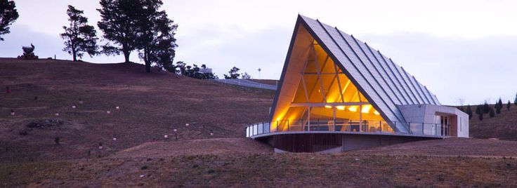 Exterior shot of the Margaret Whitlam Pavilion at the National Arboretum. The pavilion comes with seating, flowers and it's own internal bathrooms. There's an adjacent carpark that makes it easy for guests.