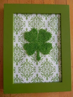 cute and simple decoration by cutting out a four leaf clover and glueing to green framed board.