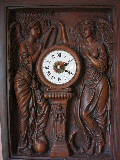 Honour and Glory Crowning Time. Replica of clock from 1st class stairway, Titanic and Olympic.