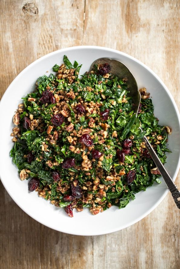 Shredded Kale Salad ________________________________________________ kale garlic cloves lemon juice olive oil black pepper dried sweetened cranberries --------------------------  FOR THE PECAN PARMESAN: 1 cup pecan halves, toasted 1.5 tablespoons nutritional yeast 1 tablespoon extra virgin olive oil 2 pinches fine grain sea salt