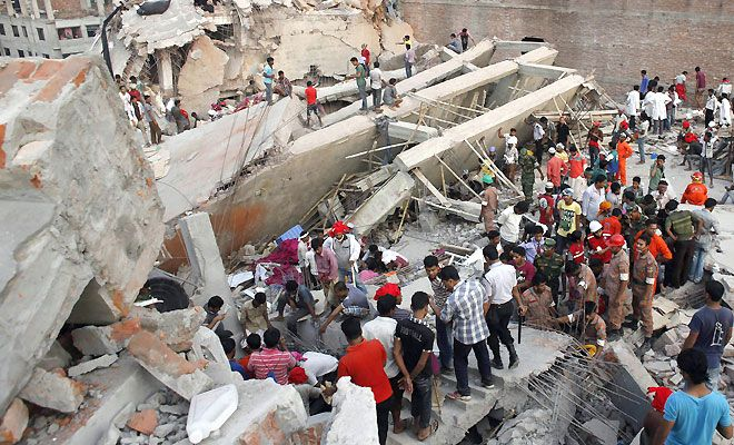 Horror in Bangladesh | Rescue workers trying to rescue trapped garment workers in the Rana Plaza building which collapsed in Savar, 30 km outside Dhaka. Photo: Reuters