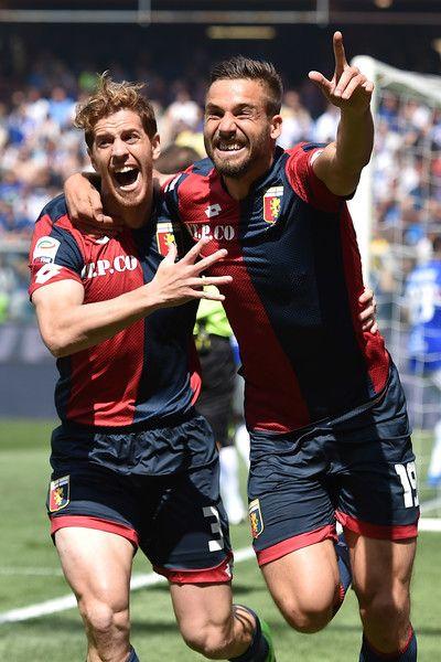 Leonardo Pavoletti (R) of Genoa CFC celebrates after scoring the opening goal with team mate Cristian Ansaldi during the Serie A match between UC Sampdoria and Genoa CFC at Stadio Luigi Ferraris on May 8, 2016 in Genoa, Italy.