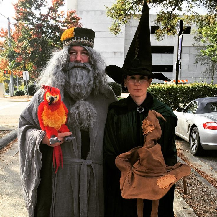 Dumbledore and McGonagall Halloween costume complete with Fawkes and the sorting hat.