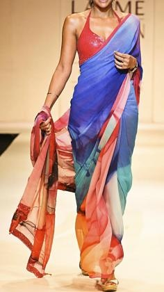 Beautiful digitally printed Satya Paul Saree detailed with floral patterns in red, blue turquoise and orange.    Satya Paul´s contemporary Indian styles of Sarees is unsurpassed within the Indian Fashion world. His Saree lines range from Silk Sarees to Net sarees with rich embroidery. Satya Paul as a designer is one of the most popular Indian designers in Bollywood. Strand of Silk (strandofsilk.com) offers a beautiful collection of Satya Paul Sarees with beautiful coloured prints.