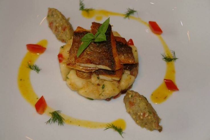 pan fried sea bass/herbed potatoes/saffrοn sauce