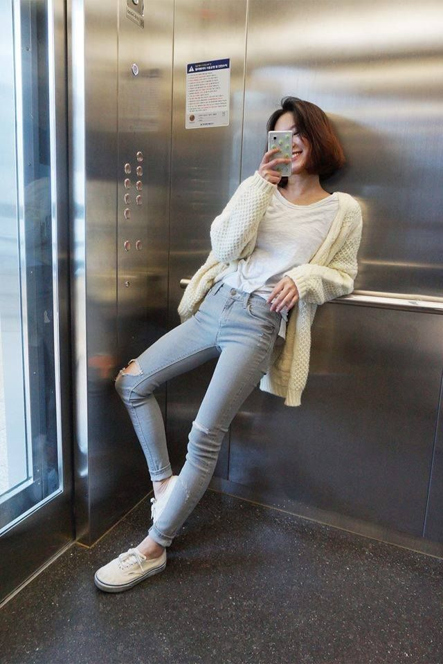 grey skinnies with knitted cardigan.