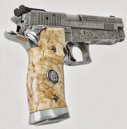 Beautifully engraved Sig Sauer.
