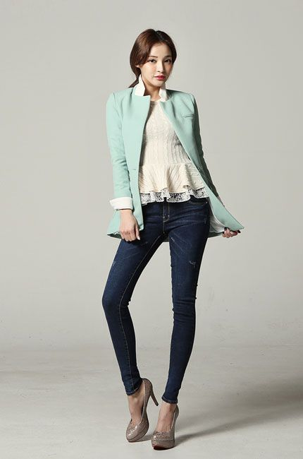 I adore the frills on the blouse. The color of the blazer is perfection.