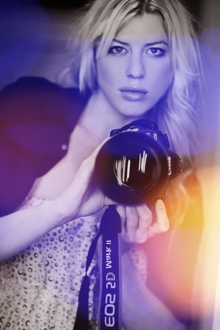 Model holding a Canon 5D, picture by Sarah-Louise Johnson.