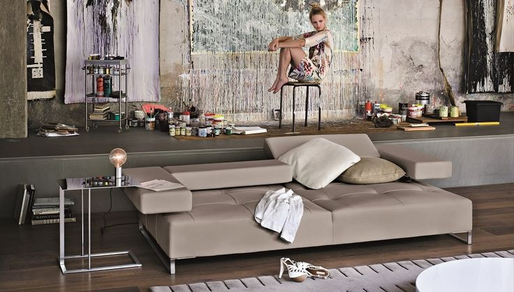 Loft by Arketipo is a modern sofa with a geometric and minimal design. Thanks to a simple mechanism, it is possible to create a series of different positions.