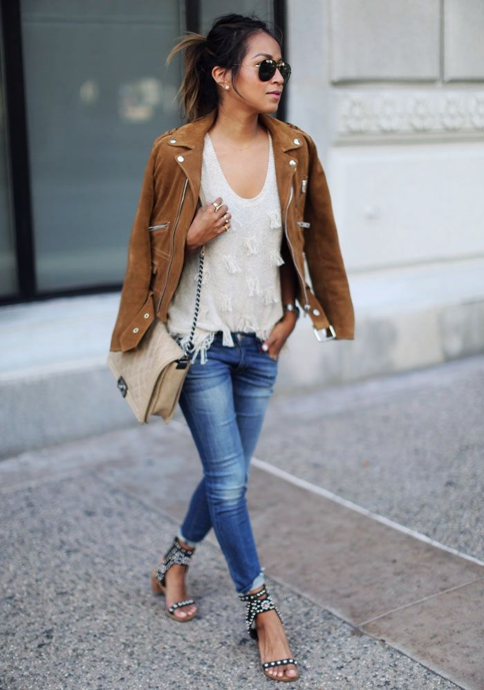 We adore the way Jules Sarinara styled her suede moto jacket with a simple tank, jeans, and heels.