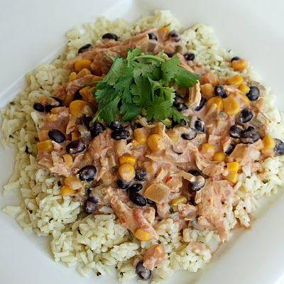 Crockpot Fiesta Chicken! Chicken. black beans, corn, salsa, cream cheese. Serve over rice or in wrap.