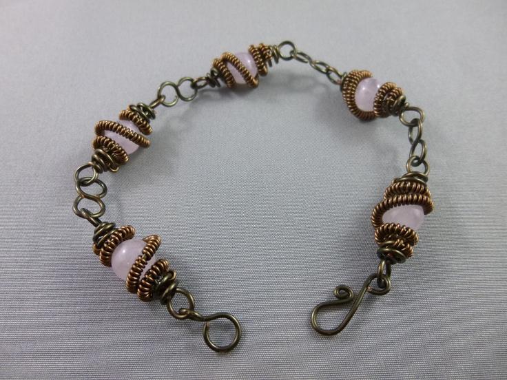 Rose quartz gemstones wrapped in a bronze / copper wire.