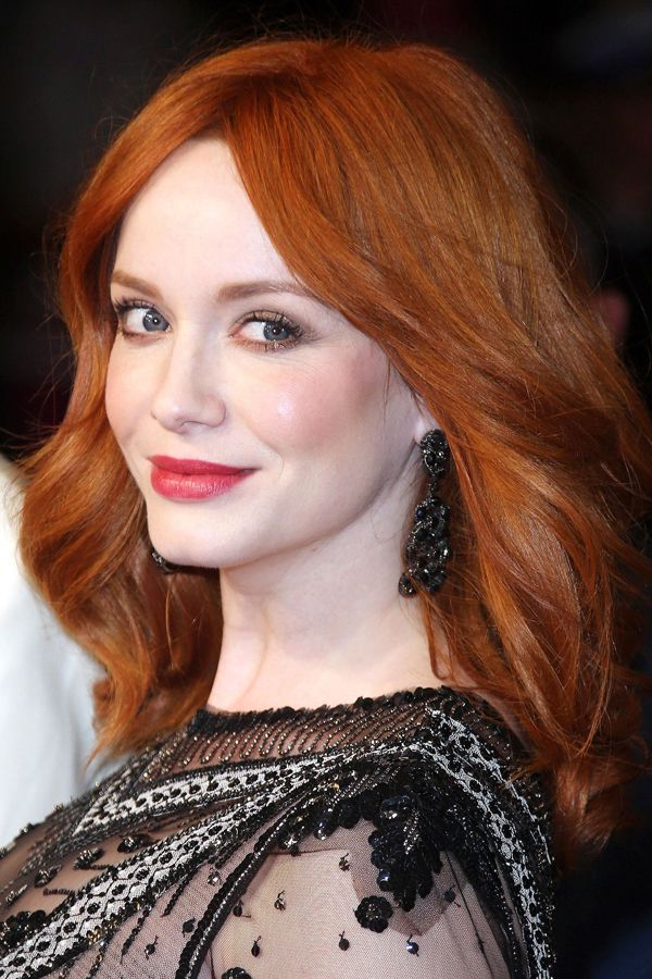 """Christina Hendricks   """"Christina is a dark copper,"""" says Friedman. She's also another example of single-process shades — an all-over color that looks beautiful against her skin (and with her signature lipstick)."""
