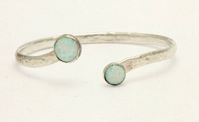 sterling silver hammered bangle set with two white opal stones (8 and 10mm). Handmade in the UK by Lavan Jewellery